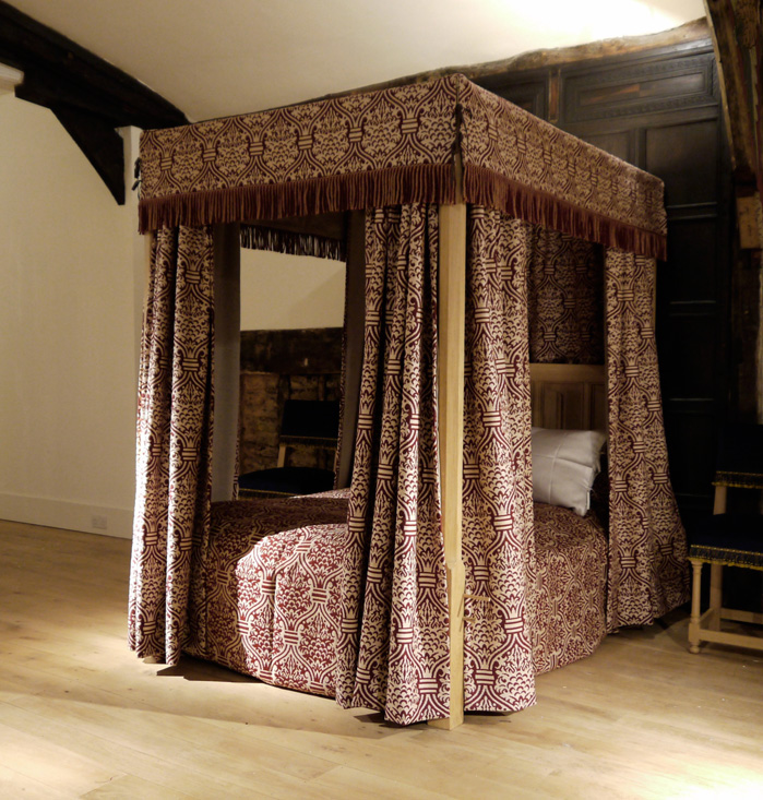 Four poster bed with Renaissance Textiles material